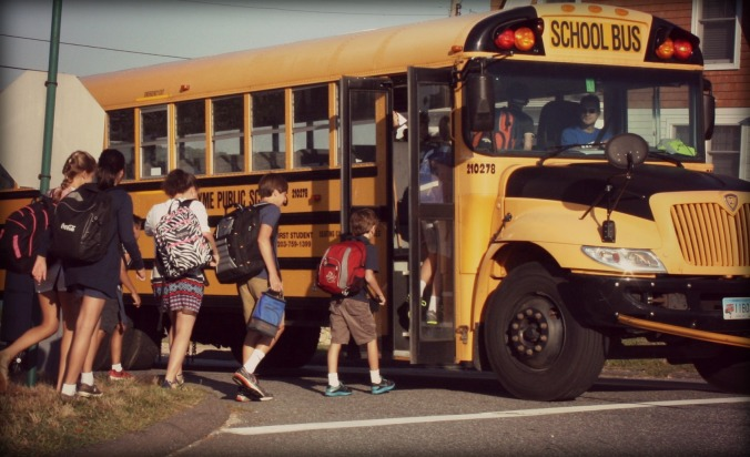Y'all, look at how TINY he is next to the rest of these kids. (He's the tiny one with the red bulging backpack.) I'm pretty sure this is the college bus. And LOOK, the kid behind mine can't fit in his lunchbox either. See??